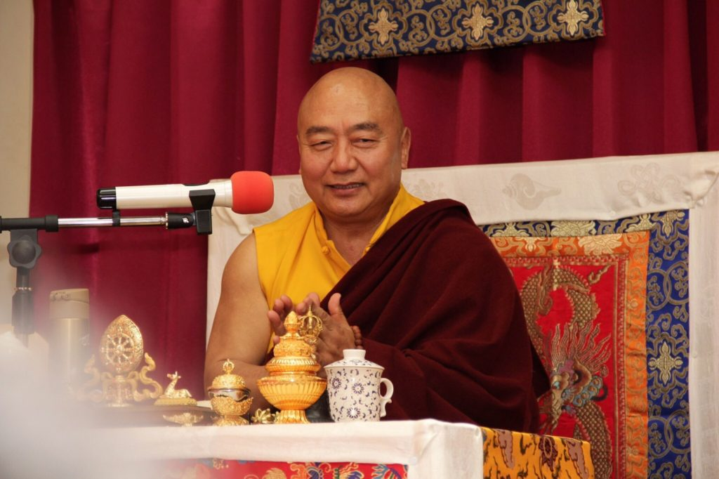 Rinpoche giving teachings